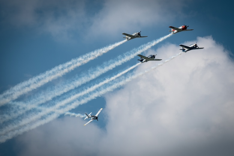 The Trojan Horsemen T-28 Demo Team performs aerobatic stunts during the Thunder Over Louisville air show in downtown Louisville, Ky., April 23, 2016. The event drew an estimated crowd of 725,000 spectators to the banks of the Ohio River. (U.S. Air National Guard photo by Maj. Dale Greer)