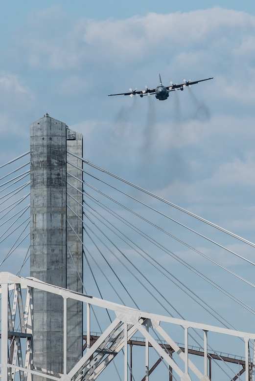 A Kentucky Air National Guard C-130 Hercules transport plane approaches the show box during the Thunder Over Louisville air show in downtown Louisville, Ky., April 23, 2016. The plane and crew airdropped two bundles of cargo into the Ohio River to demonstrate the Hercules' airlift capabilities. (U.S. Air National Guard photo by Maj. Dale Greer)