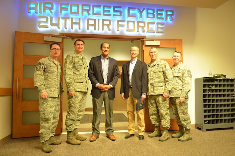 U.S. Representatives William Hurd and Mac Thornberry (TX) pose with senior leaders from 24th and 25th Air Force May 2 during a visit at Joint Base San Antonio - Lackland, Texas. The two received a series of informative cyber-related briefings, and discussed collaborative Air Force cyber and global intelligence, surveillance and reconnaissance initiatives. Thornberry is the current chair of the House Armed Services Committee, and Hurd is a member of the House Homeland Security Committee and its counterterrorism and