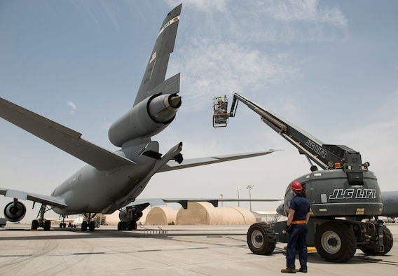 Airmen from the 380th Expeditionary Aircraft Maintenance Squadron inspect a KC-10 Extender on April 28, 2016, at an undisclosed location in Southwest Asia. The KC-10 provides air refueling capabilities to U.S. and coalition aircraft in the CENTCOM theater. (U.S. Air Force Photo by Staff Sgt. Chad Warren)