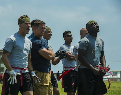 CAMP HANSEN, Okinawa, Japan – Marines and sailors with III Marine Expeditionary Force cheer on their teammates during a game of flag football April 29, 2016 on Camp Hansen, Okinawa, Japan. The game was part of a half-day event to raise funds for the Navy Marine Corps Relief Society by participating in competitive group sports. There are many ways the NMCRS can help Marines and sailors in times of need, including by providing interest-free loans and other financial assistance.