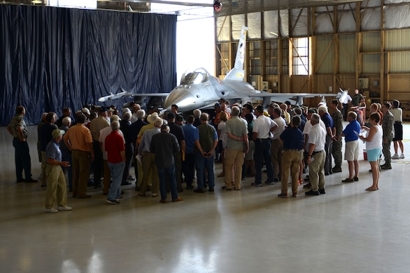 Visitors gather around an F-16CM Fighting Falcon as U.S. Air Force Maj. Matthew Feeman, 20th Operations Support Squadron wing weapons, describes its parts and function at Shaw Air Force Base, S.C., April 29, 2016. The static F-16 display was the last stop of the tour before the event came to a close. (U.S. Air Force photo by Airman 1st Class Kelsey Tucker)