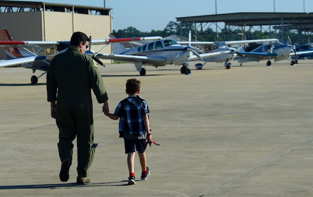 U.S. Air Force Lt. Col. Kris Padilla, 20th Fighter Wing chief of safety, and his son look at aircraft on the flight line at Shaw Air Force Base, S.C., April 29, 2016. Seventy-nine civilian aircraft and more than 100 people participated in Shaw's first General Aviation Fly-In since 1977. (U.S. Air Force photo by Airman 1st Class Kelsey Tucker)