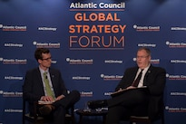 Deputy Defense Secretary Bob Work speaks with event moderator August Cole, director, Art of the Future Project, during the Atlantic Council's Global Strategy Forum in Washington, D.C., May 2, 2016. DoD photo by Air Force Senior Master Sgt. Adrian Cadiz