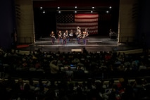 The party band section of the Marine Corps Base Quantico band plays to a full Everett High School auditorium, March 18, 2016 in Everett, Mass. The band visited the school prior to their performance in the St. Patrick's Day parade in Boston, the following weekend. Cpl. Jordan Snow, a Proctor, Vermont, native, is the bass drummer for the band and travelled back and forth between Boston and Germany to eventually become a Marine Corps musician.