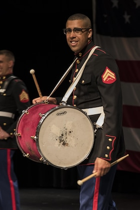 Corporal Jordan Snow, bass drummer for the Marine Corps Base Quantico band and Proctor, Vermont, native, performs with the party section of the band to a full Everett High School auditorium, March 18, 2016. The band visited the school prior to their performance in the St. Patrick's Day parade in Boston the following weekend. Snow is a Berklee College of Music graduate and travelled back and forth between Boston and Germany to eventually become a Marine Corps musician.