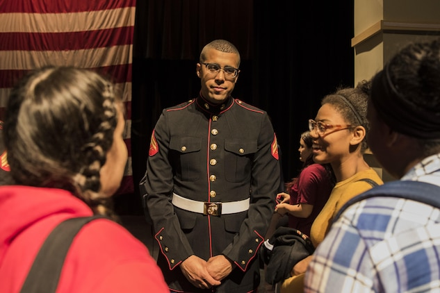 Corporal Jordan Snow, bass drummer for the Marine Corps Base Quantico band and Proctor, Vermont, native, speaks with high school band students in the Everett High School auditorium, March 18, 2016. The band visited the school prior to their performance in the St. Patrick's Day parade in Boston the following weekend. Snow is a Berklee College of Music graduate and travelled back and forth between Boston and Germany to eventually become a Marine Corps musician.