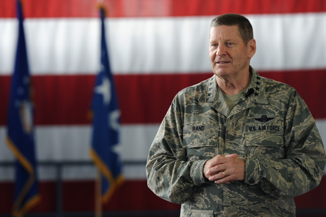 Gen. Robin Rand, AFGSC commander, speaks at an all call during his visit to Ellsworth Air Force Base, S.D., April 27, 2016. Rand touched on how important family and resiliency is to him, as well as the purpose of modernizing the Air Force's aircraft fleet, including the upgrade of the B-1 bomber cockpit and weapons system officer stations. (Air Force photo by Senior Airman Hailey R. Staker)