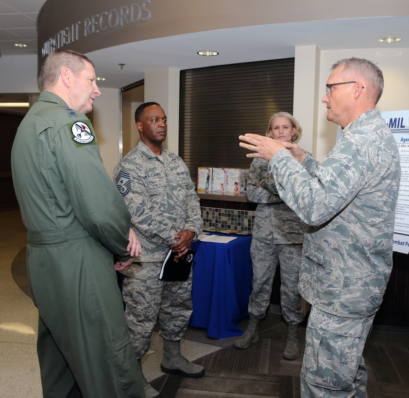 "Gen. Robin Rand, AFGSC commander, and Chief Master Sgt. Calvin Williams, AFGSC command chief, learn about the ""Mil-to-Mil"" program from Chap. (Maj.) David Knight, 28th Bomb Wing chaplain, at Ellsworth AFB, S.D., April 28, 2016. The chapel hosts seminars and retreats for couples, allowing them to take time to focus on fortifying their relationships surrounded by fellow mil-to-mil couples. (Air Force photo by Airman 1st Class Denise M. Nevins)"