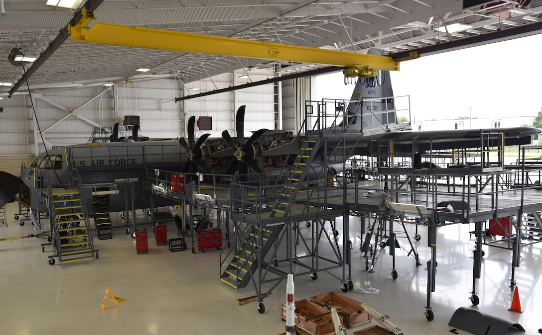 """The Air Force Reserve's 403rd Maintenance Squadron Isochronal Inspection Dock at Keesler Air Force Base, Mississippi, received new maintenance platforms, commonly referred to as """"stands,"""" April 14, 2016. The previous stands became outdated, not meeting fall protection limits, and they were not configured all the way around the aircraft. The new stands are placed completely around the aircraft to include the nose and tail sections, provide more working area and access to power and lighting. (U.S. Air Force photo/Maj. Marnee A.C. Losurdo)"""