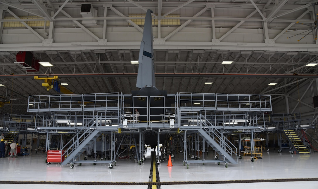 """The Air Force Reserve's 403rd Maintenance Squadron Isochronal Inspection Dock at Keesler Air Force Base, Mississippi, received new maintenance platforms, commonly referred to as """"stands,"""" April 14, 2016.The previous stands became outdated, not meeting fall protection limits, and they were not configured all the way around the aircraft. The new stands are placed completely around the aircraft to include the nose and tail sections, provide more working area and access to power and lighting. (U.S. Air Force photo/Maj. Marnee A.C. Losurdo)"""
