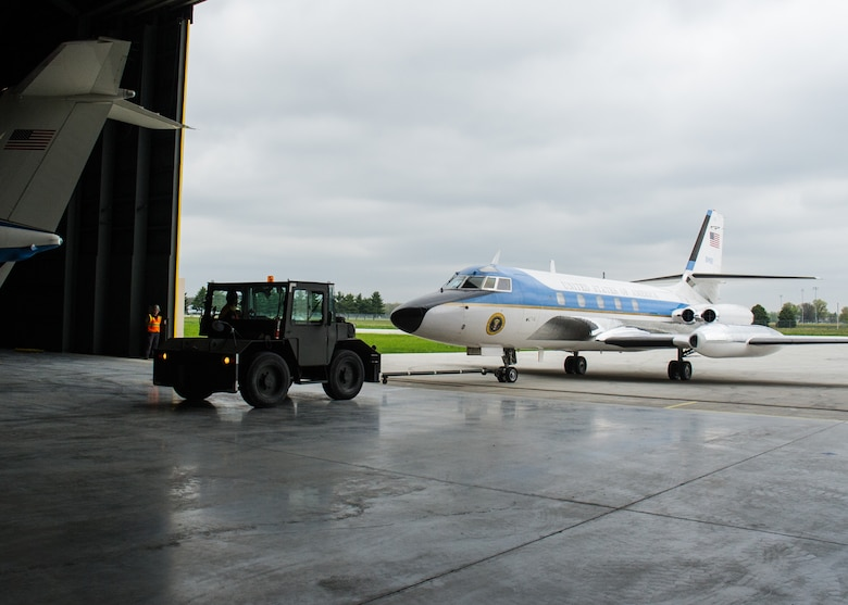 DAYTON, Ohio -- The Lockheed VC-140B JetStar being towed into the fourth building at the National Museum of the United States Air Force. (U.S. Air Force photo by Ken LaRock)
