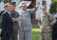 Defense Secretary Ash Carter, left, and Marine Corps Gen. Joe Dunford, second left, chairman of the the Joint Chiefs of Staff, talk with Air Force Gen. Philip M. Breedlove, center, the outgoing commander of U.S. European Command and Army Gen. Curtis M. Scaparrotti, right, the new Supreme Allied Commander Europe and commander of U.S. European Command, before the change of command in Stuttgart, Germany, May 3, 2016. DoD photo by U.S. Navy Petty Officer 1st Class Tim D. Godbee