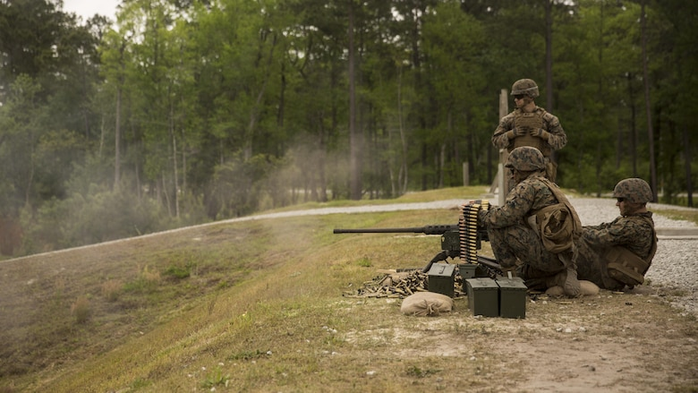 """Marines with II Marine Headquarters demonstrate, to visiting family members and spouses, how to operate the .50 Caliber Machine Gun during II MHG's: """"In Their Boots Day"""" at Camp Lejeune, N.C., April 29, 2016. The Marines also demonstrated a firing method, """"talking guns"""", using two M240 Bravo Light-Machine Guns and a .50 Caliber Machine Gun. (U.S. Marine Corps photo by Cpl. Justin T. Updegraff/ Released)"""