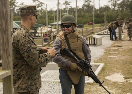 "Jill Lane, a spouse, receives positives comments after completing the course of fire during II Marine Headquarters Group's: ""In Their Boots Day"" aboard Camp Lejeune, N.C., April 29, 2016. During the course of fire, they shot in the standing, kneeling and prone position and received any needed corrections from the Marine assigned to them. (U.S. Marine Corps photo by Cpl. Justin T. Updegraff/ Released)"