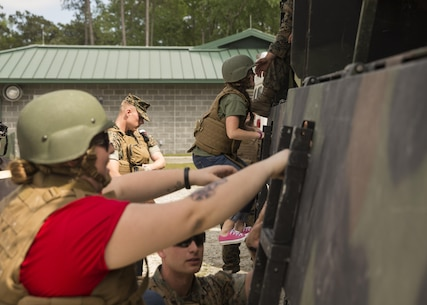 "Spouses and family members climb into the back of 7 tons and go on a short tour of the training area during II Marine Headquarters Group's: ""In Their Boots Day"" aboard Camp Lejeune, N.C., April 29, 2016. From eating Meals Ready to Eat to conducting a live fire range, family members and spouses experienced what the Marine Corps is all about. (U.S. Marine Corps photo by Cpl. Justin T. Updegraff/ Released)"