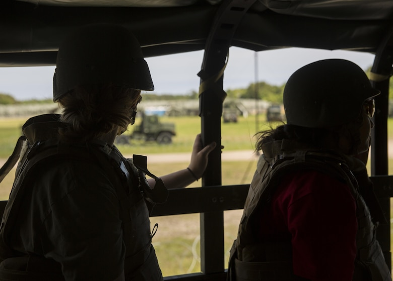 """Spouses and family members climb into the back of 7 tons and go on a short tour of the training area during II Marine Headquarters Group's: """"In Their Boots Day"""" aboard Camp Lejeune, N.C., April 29, 2016. From eating Meals Ready to Eat to conducting a live fire range, family members and spouses experienced what the Marine Corps is all about. (U.S. Marine Corps photo by Cpl. Justin T. Updegraff/ Released)"""