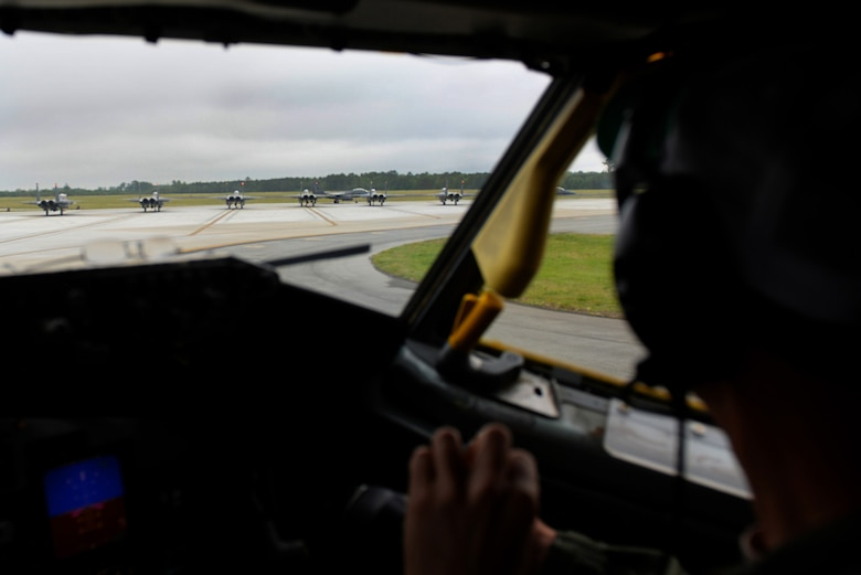 Lt. Col. Matt Young, 77th Air Refueling Squadron pilot, observes F-15E Strike Eagle aircraft preparing to take off, April 27, 2016, at Seymour Johnson Air Force Base, North Carolina. Young and Capt. Grant Fountain, also a 77th Air Refueling Squadron pilot, flew a KC-135R Stratotanker which accompanied the F-15Es halfway to Hill Air Force Base, Utah to participate in exercise Combat Hammer. (U.S. Air Force photo by Senior Airman Patrick Cole/Released)