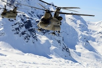 Two CH-47F Chinook helicopters fly through the Alaska Range enroute to base camp on Kahiltna Glacier, Alaska, April 24, 2016. Army photo by John Pennell
