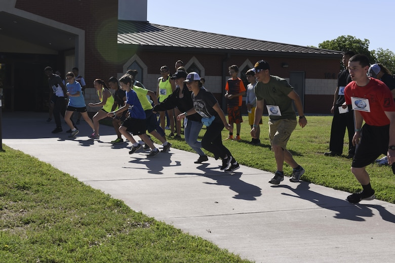 Participants of the 6th annual Sexual Assault Response Coordinator Challenge sprint for the first objective at the Taylor Chapel on Goodfellow Air Force Base, Texas, April 30, 2016. The challenge raised awareness of Sexual Assault Prevention and Response through engaging participants in games and riddles. (U.S. Air Force photo by Airman 1st Class Chase Sousa/Released)
