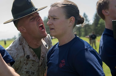 Senior Drill Instructor, Staff Sgt Trevon Wilson, encourages a poolee at the Recruiting Station Portland Aunnual pool function aboard Camp Rilea, Warrenton, Oregon. Poolees were given an oppurtunity during a 3-day training event to experience aspects of recruit training to include the presence of drill instructors and physical training.(U.S. Marine Corps photo by Sgt. Taylor Morton)