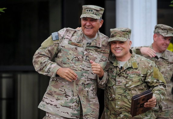 Lt. Gen. Brad Heithold, AFSOC commander, is escorted by Chief Master Sgt. Matt Caruso, Air Force Special Operations Command command chief, out to a crowd of Airmen prior to presenting him with an AFSOC Order of the Sword invitation May 2, 2016, at Hurlburt Field, Fla. An estimated 150 people joined the command chief to present Heithold his invitation. The Order of the Sword, which is the highest award the enlisted corps can bestow upon an officer, draws its heritage from military tradition where non-commissioned officers honor leaders who have made significant contributions to the enlisted corps. (U.S. Air Force photo/Senior Airman Meagan Schutter)