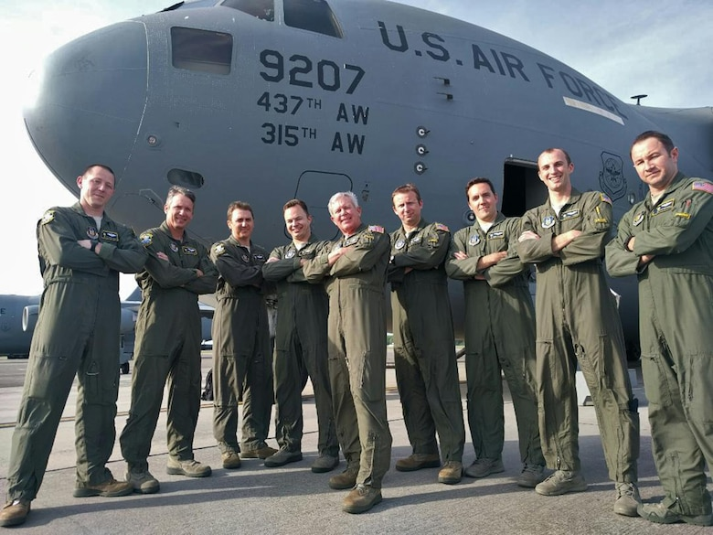 An aircrew from the 300th Airlift Squadron sport their flight suit morale tabs in front of their C-17 Globemaster III before performing the squadron's first flight using their newly approved call sign Primus. Bronze, Prime and Turtle – these are the new call signs now used by Reserve aircrews assigned to the 315th Airlift Wing at Joint Base Charleston, South Carolina. (U.S. Air Force photo by Michael Dukes)