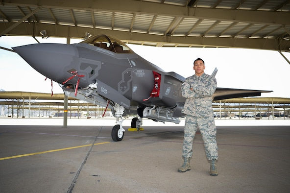 Staff Sgt. Aaron Ramirez, a reservist in the 419th Aircraft Maintenance Squadron, stands beside an F-35 Lightning II at Hill Air Force Base, Utah, April 26. (U.S. Air Force photo/R. Nial Bradshaw)