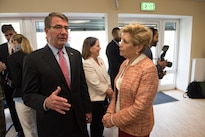Defense Secretary Ash Carter and Ellyn Dunford, the wife of Gen. Joe Dunford, chairman of the Joint Chiefs of Staff, talk before the change-of-command ceremony for U.S. European Command at Patch Barracks in Stuttgart, Germany, May 3, 2016. DoD photo by D. Myles Cullen