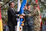 Defense Secretary Ash Carter presents the U.S. European Command flag to Eucom's new commander, Army Gen. Curtis M. Scaparrotti, during a change of command ceremony in Stuttgart, Germany, May 3, 2016. DoD photo by D. Myles Cullen