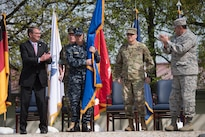 Defense Secretary Ash Carter, Marine Corps Gen. Joe Dunford, second from left, chairman of the Joint Chiefs of Staff, and Air Force Gen. Philip M. Breedlove, outgoing commander of U.S. European Command, applaud Army Gen. Curtis M. Scaparrotti, second from right, the command's new commander, during a ceremony in Stuttgart, Germany, May 3, 2016. DoD photo by D. Myles Cullen