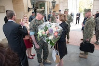 Marine Corps Gen. Joe Dunford, chairman of the Joint Chiefs of Staff, talks with Cindy Scaparrotti, the wife of Army Gen. Curtis M. Scaparrotti, the new commander of U.S. European Command, as she  holds a bouquet of flowers after the change-of-command ceremony in Stuttgart, Germany, May 3, 2016. DoD photo by D. Myles Cullen