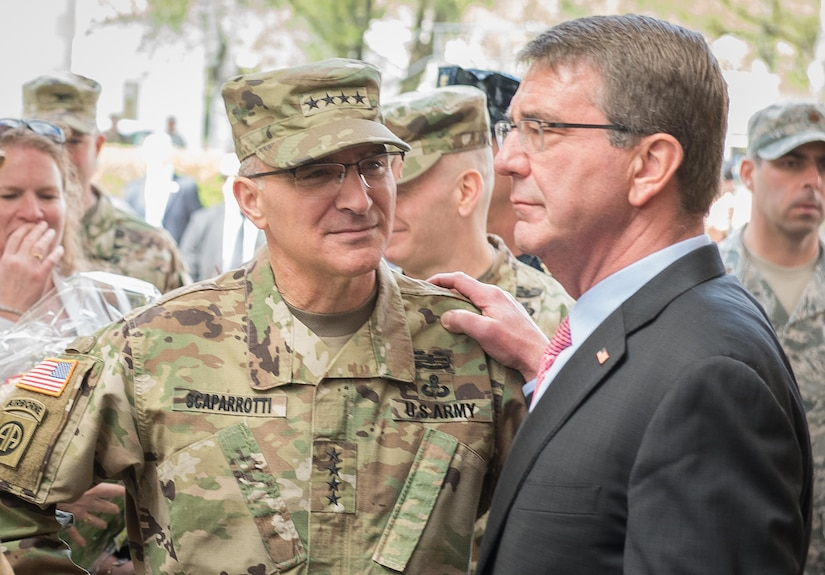 Defense Secretary Ash Carter and Army Gen. Curtis M. Scaparrotti, incoming commander of U.S. European Command, share a moment during the ceremony to change commanders in Stuttgart, Germany, May 3, 2016. DoD photo by D. Myles Cullen