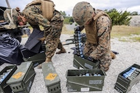 Marines prepare MK-19 automatic grenade launcher ammunition for a training event at Camp Lejeune, N.C., April 29, 2016. The training honed the Marines' accuracy, communication and suppressive fire skills. Marine Corps photo by Lance Cpl. Aaron K. Fiala