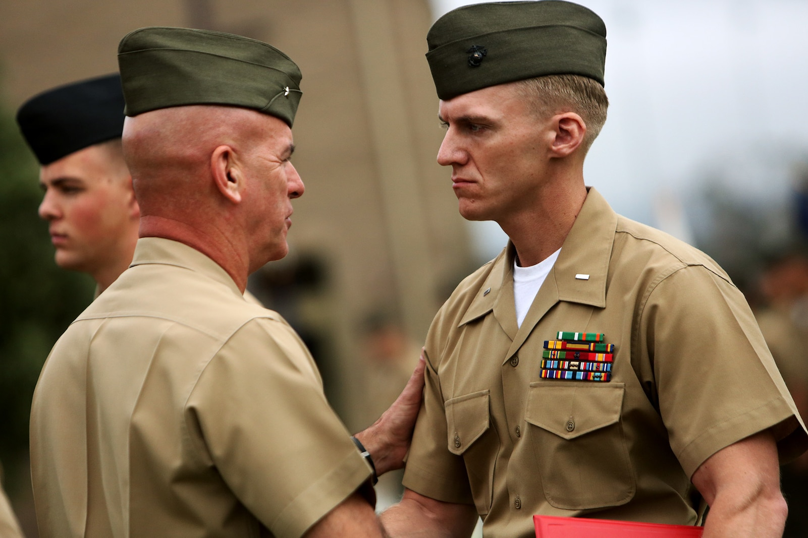 U.S. Marine 1st Lt. Frankie Doerr is handed an award during an awards ceremony aboard Camp Pendleton, Calif., April 22, 2016. Doerr is the 2nd platoon commander with Motor Transportation Company, Combat Logistics Battalion 5. Ten Marines and Sailors with 1st Marine Logistics Group were recognized for their outstanding performance throughout the year. Awards ranged from a Certificate of Commendation, Marine of the year, Noncommissioned Officer of the Year, and the Navy and Marine Corps Achievement Medal.  (U.S. Marine Corps photo by Sgt. Laura Gauna/released)