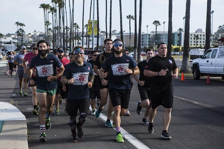 SAN DIEGO – Marines with 1st Reconnaissance Battalion run the last six miles of a 1,500 mile run in honor of Sam Leonard, in San Diego April 29, 2016. In fall 2014, at the age of 73, Sam set out to walk across the country to raise funds for the Travis Manion Foundation, which supports veterans and families of the fallen and is named after a fallen recon Marine. He began in Florida but was forced to stop in Houston when he was diagnosed with stage 4 stomach cancer. He sadly passed away four months later. Albie Masland, the TMF west coast veteran service manager reached out to his good friends and TMF ambassadors Nick Biase and Matt Peace, to see if they wanted to help honor Sam by completing the last 1,500 miles of his journey and raise money for the TMF on his behalf. They finished the trek in 30 days at the USS Midway and on the anniversary of Travis Manion's death. (U.S. Marine Corps photo by Sgt. Anna Albrecht/ Released)
