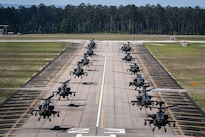 AH-64D Apache helicopters begin to depart in formation from McEntire Joint National Guard Base, Eastover, S.C., April 23, 2016, to participate in gunnery qualifications and annual training at Fort Stewart, Ga. South Carolina Army National Guard photo by Staff Sgt. Roberto Di Giovine