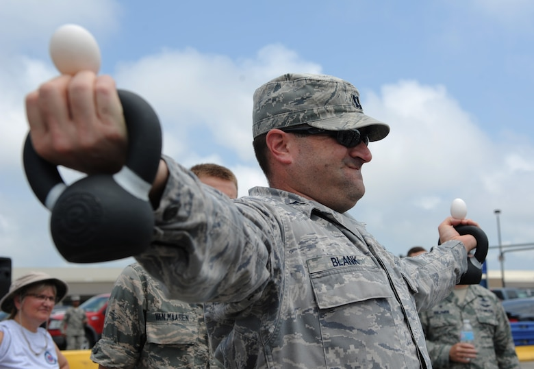 Capt. Gregory Blank, 333rd Training Squadron instructor, competes in a dragon egg hold competition during a burger burn April 29, 2016, Keesler Air Force Base, Miss. The burger burn was the final event of Wingman Week in support of Comprehensive Airman Fitness. (U.S. Air Force photo by Kemberly Groue)