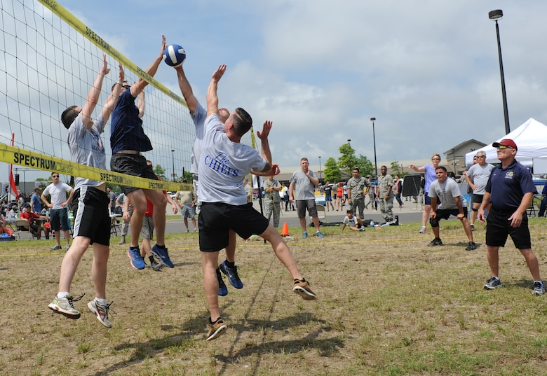 "Members of the 81st Training Group volleyball team and ""The Chiefs"" play volleyball during a burger burn April 29, 2016, Keesler Air Force Base, Miss. The burger burn was the final event of Wingman Week in support of Comprehensive Airman Fitness. (U.S. Air Force photo by Kemberly Groue)"