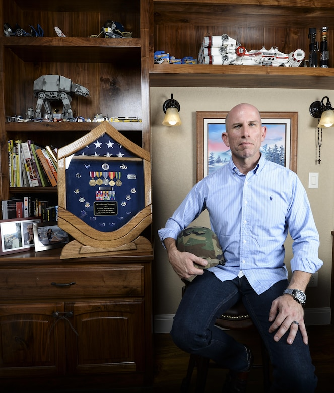 Daniel Schaeler, a nuclear quality assurance inspector in the aerospace industry, poses next to career memorabilia displayed in his Texas home July 18, 2014. Schaeler is a former Air Force logistician who retired after 24 years of service. (U.S. Air Force photo/Staff Sgt. Kevin Iinuma)