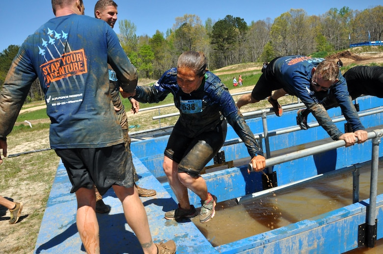 Recruiters from Dobbins Air Reserve Base, Ga. help a fallen member that almost made it to the end of the Pole Cat obstacle at the Savage Race on April 9, 2016 in Dallas, Georgia. The participants proudly showed the spirit of never leaving a wingman behind. (U.S. Air Force photo by Senior Airman Lauren Douglas)