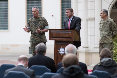 Defense Secretary Ash Carter, Marine Corps Gen. Joe Dunford, chairman of the Joint Chiefs of Staff; and Army Gen. Curtis M. Scaparrotti, commander of U.S. European Command, holding a press conference.