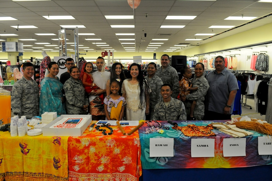 Beale's Asian American Pacific Islanders Heritage (AAPIH) Month committee members pose for a photo during a cake cutting ceremony at Beale Air Force Base, California, May 2, 2016. The celebration was to kick-off (AAPIH) Month events. (U.S. Air Force photo by Senior Airman Michael Hunsaker)