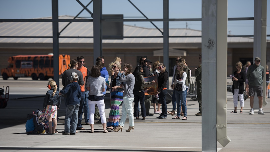 Family members gather, waiting for their loved ones returning from deployment, at Mountain Home Air Force Base, Idaho, April 17, 2016. Airmen from the 391st Fighter Squadron were deployed in support of Operation Inherent Resolve. (U.S. Air Force photo by Airman Alaysia Berry/Released)