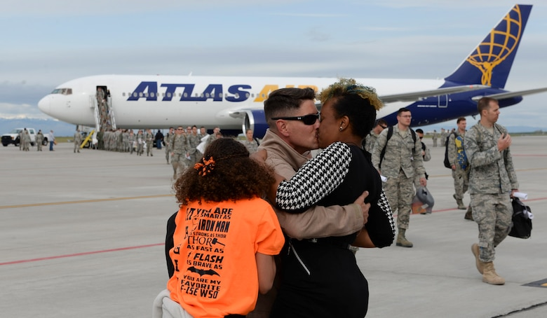 Families and loved ones welcome home airmen April 24, 2016, at Mountain Home Air Force Base, Idaho. The airmen returned from a six-month deployment to Southwest Asia in support of Operation Inherent Resolve. (U.S. Air Force photo by Airman 1st Class Chester Mientkiewicz/Released)