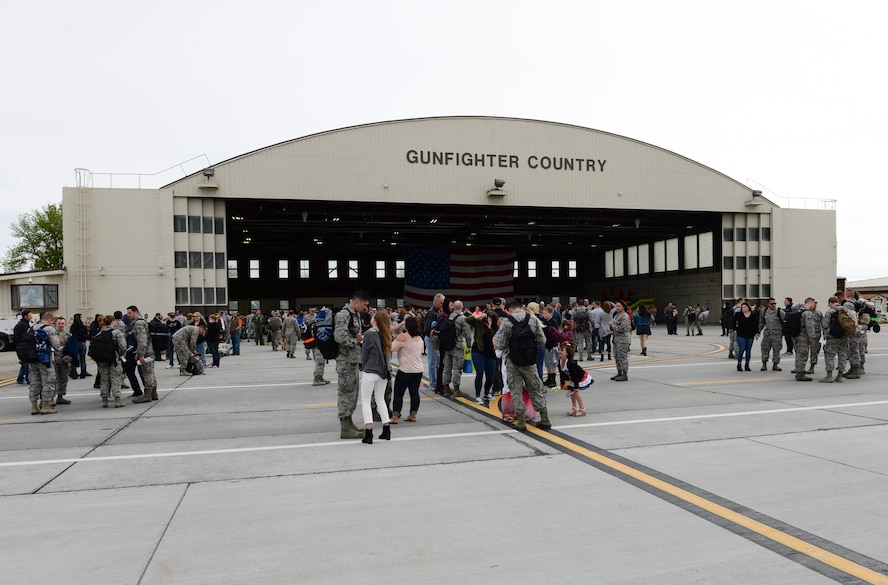Airmen return from Southwest Asia April 24, 2016, at Mountain Home Air Force Base, Idaho. The airmen were deployed in support of Operation Inherent Resolve. (U.S. Air Force photo by Airman 1st Class Chester Mientkiewicz/Released)