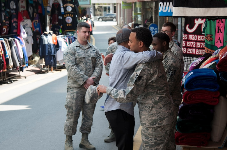 Prince Enyioko thanks Tech. Sgt. Stefan Hanyes, 51st Force Support Squadron, for helping save the lives of his wife and three children from a fire at Songtan shopping district, Republic of Korea, May 2, 2016. Service members from the 51st Fighter Wing, 8th Fighter Wing and 35th Air Defense Artillery Brigade came together to rescue the family from the burning building on April 29, 2016. (U.S. Air Force photo by Staff Sgt. Jonathan Steffen/Released)