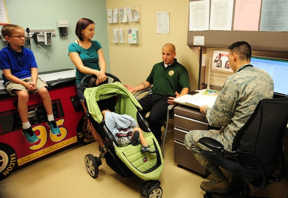 Maj. James Tschudy, a pediatrician with the 6th Medical Operations Squadron, discusses medical options with the parents of a patient during a routine check-up at MacDill Air Force Base, Fla., April 21, 2016. As a former military child, Tschudy relates to the lifestyle and challenges military children face and loves taking care of military children because military children are amazing and resilient. (U.S. Air Force photo by Senior Airman Jenay Randolph)