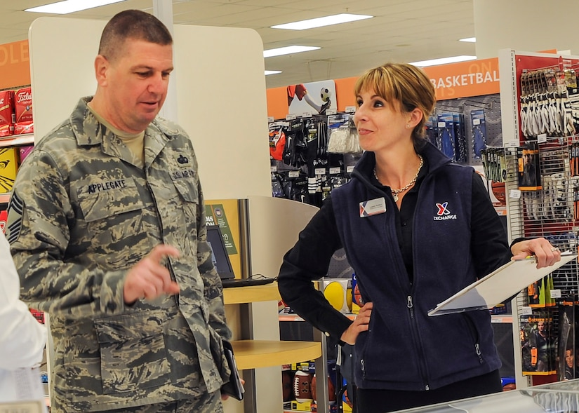 Chief Master Sgt. Sean Applegate, the Army Air Force Exchange Services senior enlisted advisor, meets with Exchange employees during a tour of the Joint Base Charleston Exchange, April 20, 2016. If service members are unable to find what they're looking for at their local Exchange, the online site, shopmyexchange.com, offers a wide assortment of national brands. (U.S. Air Force Photo/Airman Megan Munoz)