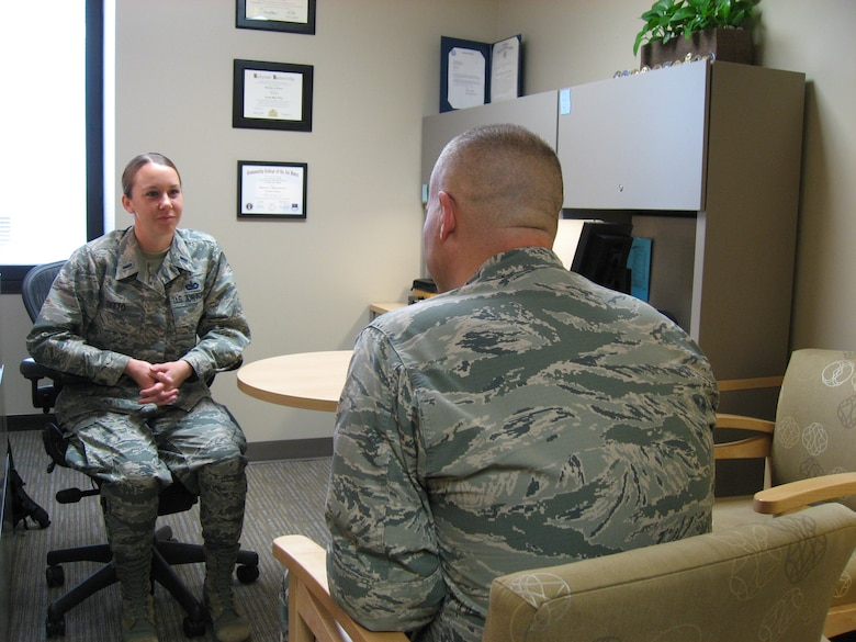 Maj. Thomas Smith, Mental Health Flight clinical training director and 1st Lt. Crystal Ditto, clinical social worker demonstrate a counseling session in the Mental Health Flight, located in the Wright-Patterson Medical Center.  (U.S. Air Force photo / Kimberly Gaither)